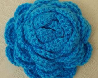 Handmade crochet flower brooch.