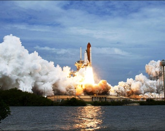 24x36 Poster . Space Shuttle Atlantis Launches From Pad 39A Sts-135