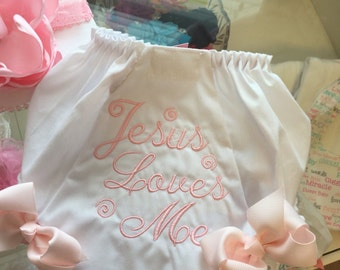 Jesus loves me baby bloomers with attached bows.