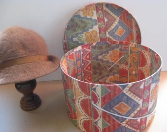 Beautiful colored carton hatbox with an English KANGOL hat.