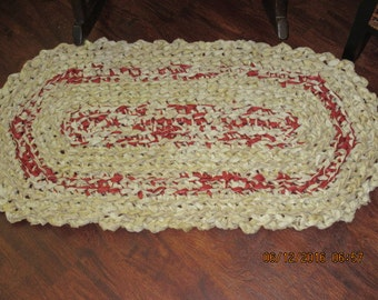 Crocheted rag rug.  Burgandy and tan. Heavier than I usually make.  It measures 19 by 36.  Washable.   Shipping included.   JW113