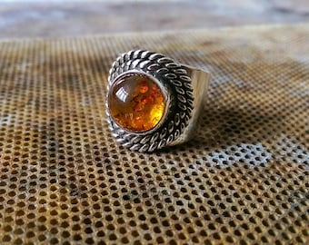 Amber in a wide Stirling silver band