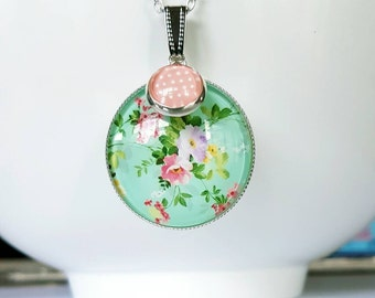 Floral glass cabochon silver pendant necklace.