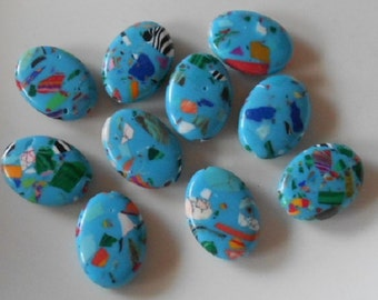 Pack of 10 synthetic howlite oval beads, pale blue multi