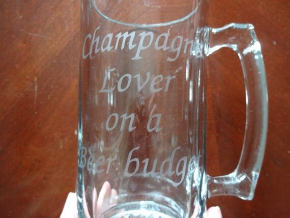 """Glass etched champagne lover beer mug with """"Champagne lover on a beer budget"""" etched on it"""