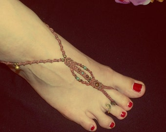 Foot band in maroon with green stones and bells