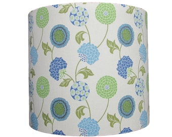 Handmade drum lampshade with stylised flowers on a cream ground