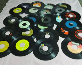 50--45 RPM Records. Great for Decorating, Crafting, Playable  and More. I am including 3 Middle Inserts.