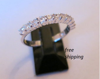 Silver cubic zirconia band ring, size 7;  in 92.5 sterling silver