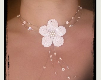 Necklace made with ivory pearls and flower sequins