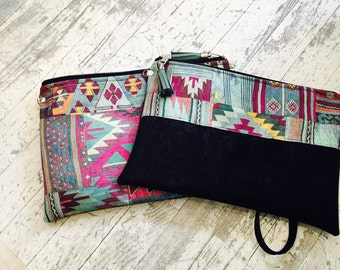 Clutch Bag in wax african print with wrist strap or shoulder strap, ethnic print green and fuchsia with black suede fabric