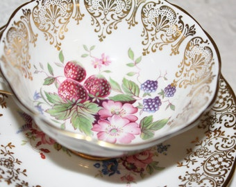Paragon: Gold & White Teacup and Saucer Fruits and Flowers Mismatched w/Hammersley Saucer Very Nice Indeed