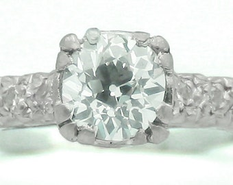 Vintage .90 carat Old European Diamond Platinum Engagement ring. Circa 1930.