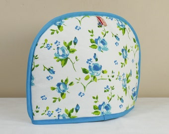 Tea cosy in turquoise flower design