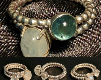 Stackable rings with either a faceted stone or a Moonstone or labradorite cab.