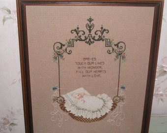 Cross stitch newborn baby gift. Baby in cradle. Gift . wall decor handmade handstitched