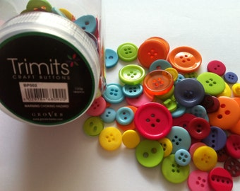 Trimits 120g pot of bright buttons in a variety of sizes and colours.