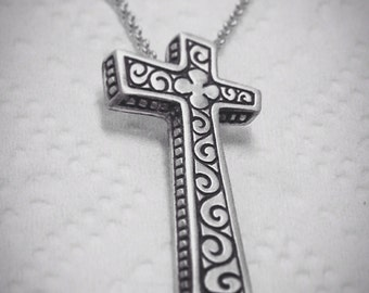 Hand engraved sterling silver cross.