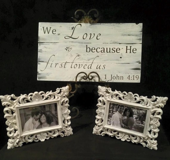 We love because he first loved us wooden sign