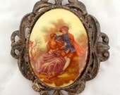 Vintage Fragonard Brooch, Victorian Lovers Scene Art Transfer In Brass Toned Setting With Both Pin And Pendent Back.