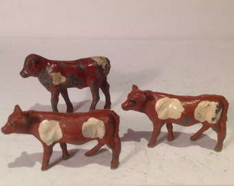 3 vintage calves (2 by Timpo the other by John Hill)  Metal