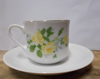 Teacup painted with yellow roses and Mitterteich Bavaria saucer made of porcelain.
