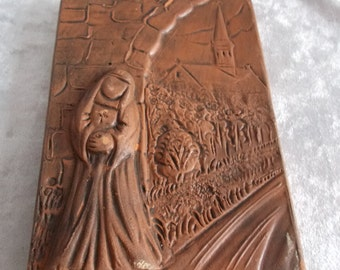 Tile of terracotta / stoneware in catholic style with nun and abbey decor.