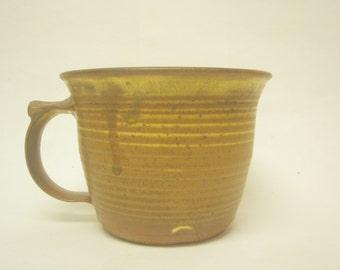 Wheel thrown Stoneware mug. Glazed with Yellow Salt.