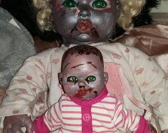 Up cycled baby doll zombie with baby zombie to cuddle burnt melted nasty undead walker Christmas ooak