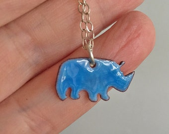Small cute Hippo necklace on a Sterling Silver Chain. Wearable for both children and adults.