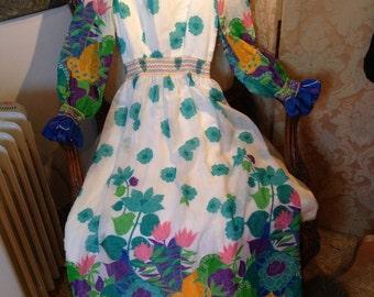 1970's maxi dress. Muslin/smocked. 38 bustx26x56 length. Stunning. Vintage