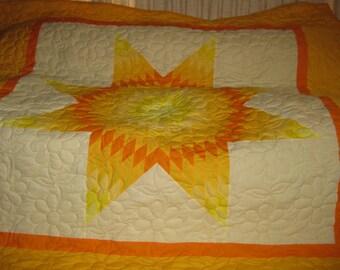 yellow-orange star quilt