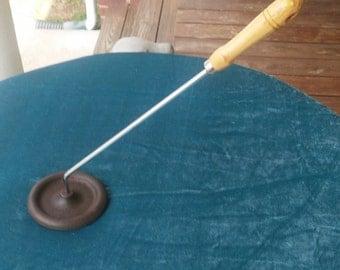 A Vintage Creme Brulee Cast Iron Caramelizer