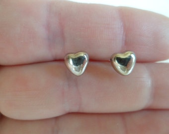 "Tiny stud earrings ""Hearts"". Sterling silver 925."