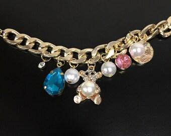 Gold Tone a linked Charm Bracelet