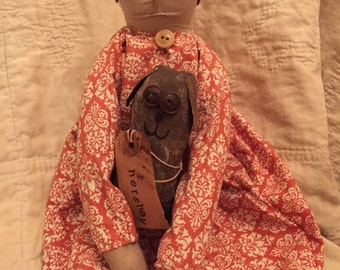 Folk art doll and dog