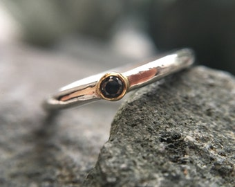 Delicate black diamond stacking ring with 18ct gold setting