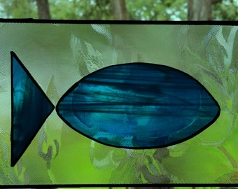 Aqua blue stained glass fish glued on frosted clear glass sun-catcher