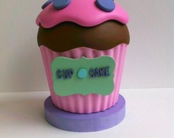 Adorable pink and purple cupcake keepsake jar.