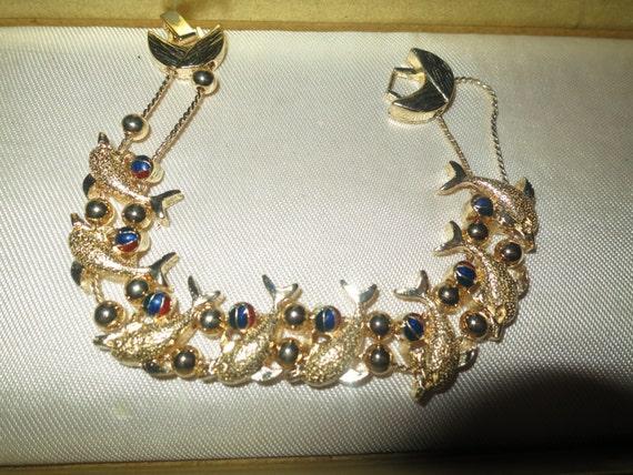 Lovely 1980s new goldtone slider bracelet with dolphins and enamel balls