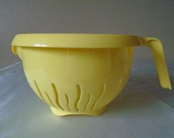 yellow plastic colander.