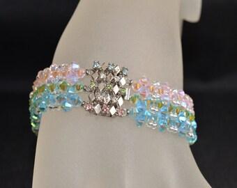 "Bracelet swarovski crystal cuff ""Tri-fantastic"" rosaline ab2x, ab2x peridot and aquamarine crystal sandwiched rockeries ab2x"