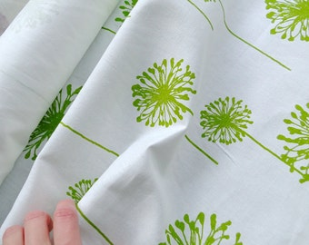 Cotton fabric by Premier Prints, sold by 1/2 yard, green dandelions on white