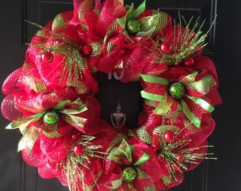 Christmas deco mesh wreath with glitter pine, ribbon, and ornament accents