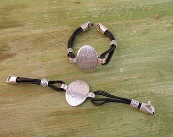 60. Leather bracelet with clasp and zamak embellishments