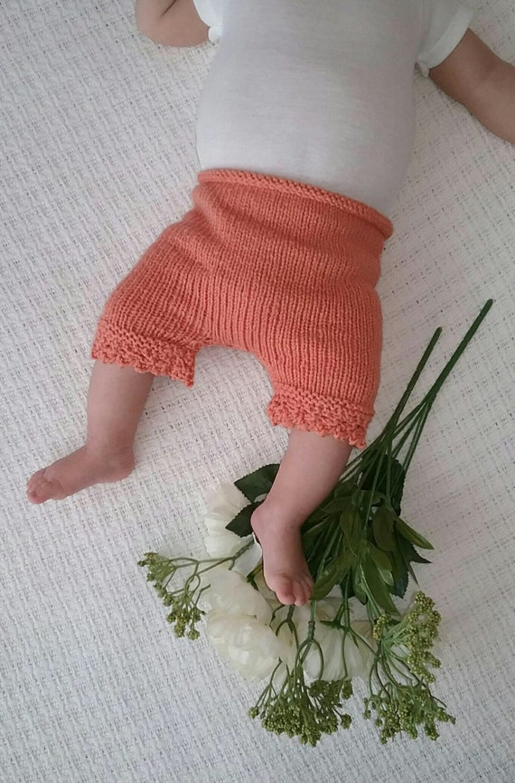 Hand knit diaper cover bloomers with knit lace pattern at end of leg  Very soft and stretchy yarn Fits Newborn to 3 mos