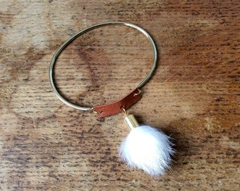 Fur with camel leather and gold metal bracelet
