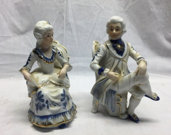 Pair of vintage porcelain/china man and woman figurines