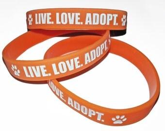 "Set of 5 - ""Live. Love. Adopt."" Orange Silicone Bracelets - Animal Rescue bracelets"