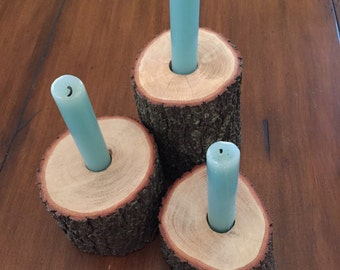 Set of rustic, real-wood log candle holders
